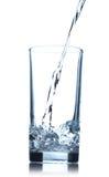 Agua de colada en el vidrio Fotografía de archivo