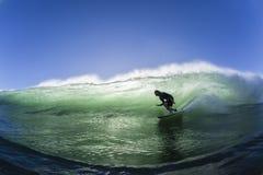 Agua de la natación de la onda que practica surf Imágenes de archivo libres de regalías