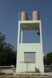 Agua de la torre de la transmisión Fotografía de archivo libre de regalías