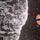 Agua de las rocas de las piernas del mar de Bali Imagenes de archivo