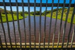Agua de madera de la cubierta de la cerca Imágenes de archivo libres de regalías
