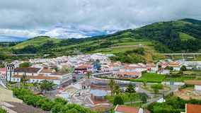 Agua De Pau town on Sao Miguel island, Azores, Portugal. Aerial view of Agua De Pau town and green mountains of Sao Miguel island of Azores, Portugal royalty free stock image