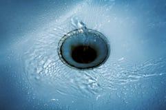Agua en un fregadero Foto de archivo libre de regalías