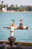 Agua escapada de las válvulas Foto de archivo libre de regalías