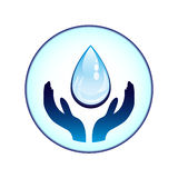 Agua-gota y manos Imágenes de archivo libres de regalías