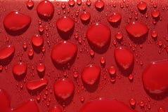 Agua-gotas en rojo Foto de archivo libre de regalías