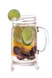 Agua infundida de la fruta fresca de la uva, del pepino y de la naranja aislante Imagen de archivo libre de regalías