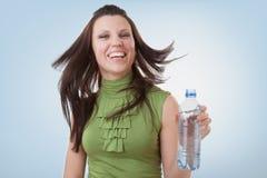 Agua mineral y muchacha en botella Foto de archivo libre de regalías