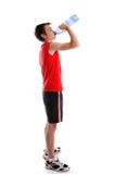 Agua potable de la persona de deportes de la botella Fotos de archivo