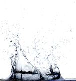 Agua que cae en agua Fotos de archivo libres de regalías