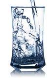 Agua Spash en un vidrio Imagenes de archivo