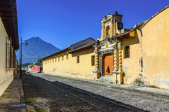 Agua volcano & cobblestone street, Antigua, Guatemala. Agua volcano & typical cobblestone street in colonial city & UNESCO World Heritage Site of Antigua royalty free stock images