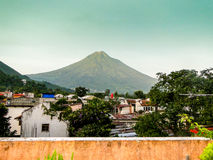 Agua Volcano at dusk. From the roof of a home in Antiqua, Guatemala royalty free stock image