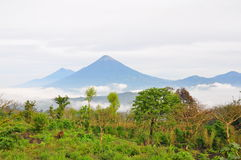 Agua Volcano, Guatemala. Volcan de Agua above the mist covered Antigua, Guatemala Stock Photography