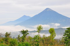 Agua Volcano, Guatemala. Volcan de Agua above the mist covered Antigua, Guatemala royalty free stock image