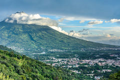 Agua volcano towers over Antigua, Guatemala. View of Agua volcano towering over Spanish colonial town & UNESCO World Heritage Site of Antigua in Panchoy Valley stock photography