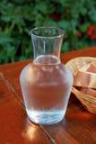 Agua y pan Imagenes de archivo