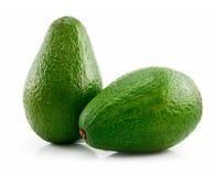 Aguacate maduro verde dos aislado en blanco Imagen de archivo libre de regalías