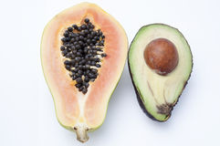 Aguacate y papaya Imágenes de archivo libres de regalías
