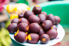 Aguaje, Amazonian Peruvian Fruit. Aguaje, it is a amazonian peruvian Fruit.  It is about the size of an egg with purple scale.  The flesh is of a bright yellow Royalty Free Stock Image