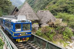 Peru Rail train arriving at Machu Picchu Station. Aguas Calientes, Peru - Sep 14, 2018: Peru Rail train arriving at Machu Picchu Station in Aguas Calientes royalty free stock photo