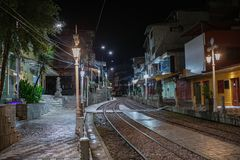 Aguas Calientes at 4am before sunrise to get to Macchu Picchu on the 15th of march 2019. Night getting up lightpole street trainrails lights morning first early stock photography