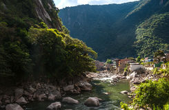 Aguas Calientes. The town and railway station at the foot of the sacred Machu Picchu mountain, Peru royalty free stock photography