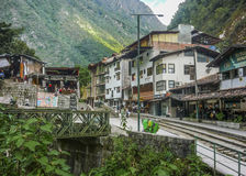 Aguas Calientes Town Tren Station in Peru. Buildings, tren station and small bridge day scene in Aguas Calientes town in Peru royalty free stock photos