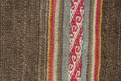 Aguayo andean  loom. Andean textile yarn and woven by hand in alpaca wool and sheep with natural brown background Royalty Free Stock Photo