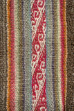 Aguayo andean  loom. Andean textile yarn and woven by hand in alpaca wool and sheep with natural brown background Royalty Free Stock Image