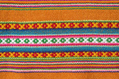 Aguayo andean  loom. Andean textile yarn and woven by hand in alpaca wool and sheep with natural brown background Stock Photo