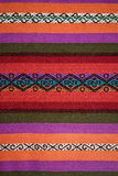 Aguayo andean  loom. Andean weaving loom made in bright colors Stock Photo