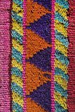 Aguayo andean  loom. Andean weaving loom made in bright colors Stock Image