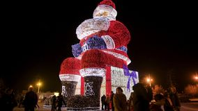 Worlds biggest Santa Claus iluminated by Christmas lights. AGUEDA, PORTUGAL - CIRCA DECEMBER 2018: Worlds biggest Santa Claus with 21 meters hight, iluminated by stock video