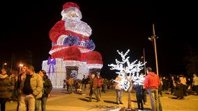 Worlds biggest Santa Claus iluminated by Christmas lights. AGUEDA, PORTUGAL - CIRCA DECEMBER 2018: Worlds biggest Santa Claus with 21 meters hight, iluminated by stock footage
