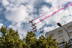 Aguila Patrol jet fighters flying with coloured smoke. Madrid, Spain - October 12, 2017: Aguila Patrol jet fighters flying with coloured smoke in Spanish Stock Photo