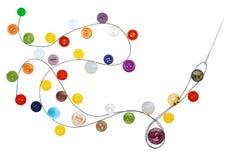 Aguja de costura con el hilo negro y los diversos botones Imagen de archivo