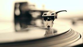 Aguja de DJ en expediente de giro
