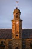 Aguja de la iglesia de la puesta del sol Foto de archivo libre de regalías