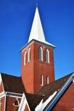 Aguja de la iglesia del ladrillo Imagenes de archivo