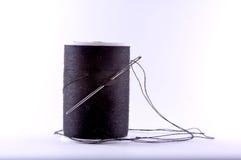 Aguja y cuerda de rosca Imagenes de archivo