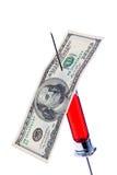 Aguja y jeringuilla con una cuenta de dólar Fotografía de archivo