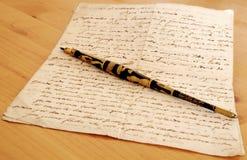 Aguja y manuscrito antiguo Fotos de archivo libres de regalías