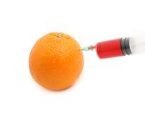 Aguja y naranja Foto de archivo libre de regalías
