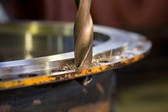 Agujeree la perforación en el metal Imagen de archivo libre de regalías