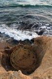 Agujero de agua en orilla Imágenes de archivo libres de regalías