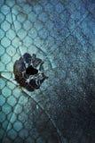 Agujero de bala en ventana Imagenes de archivo