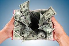 Agujero de los billetes de banco de los dólares Foto de archivo libre de regalías