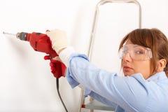 Agujero de perforación femenino Foto de archivo libre de regalías