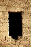 Agujero en la pared de piedra Imágenes de archivo libres de regalías